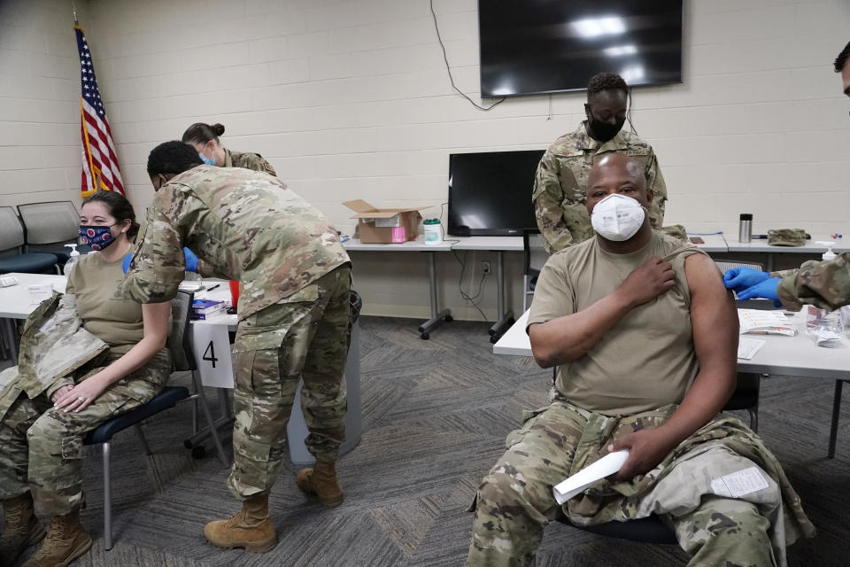 FILE - In this Dec. 23, 2020, file photo, members of the Mississippi Air and Army National Guard Guard receive the first dose of the Moderna COVID-19 vaccine in Flowood, Miss. The coronavirus vaccines have been rolled out unevenly across the U.S., but some states in the Deep South have had particularly dismal inoculation rates. (AP Photo/Rogelio V. Solis, File)