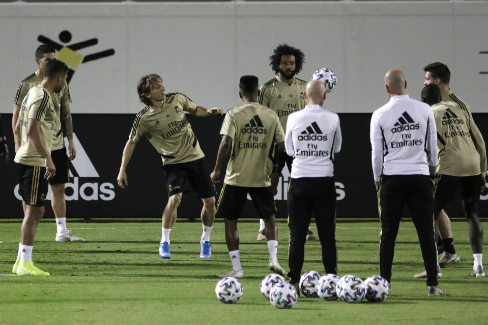 Real Madrid players warm up during a training session in Jiddah, Saudi Arabia, Tuesday, Jan. 7, 2020. Real Madrid will play the Spanish Super Cup semifinal soccer match against Valencia at King Abdullah stadium in Jiddah tomorrow. (AP Photo/Amr Nabil)
