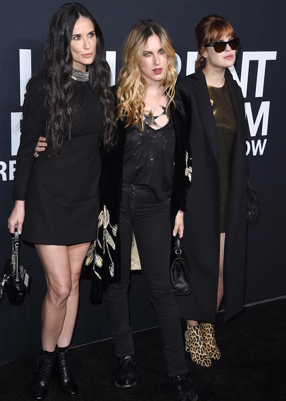 <p>Thanks to their matching all black outfits and very similar bone structures, the trio look more like sisters than mom-and-daughters at the <em>Saint Laurent</em> premiere in L.A.</p>
