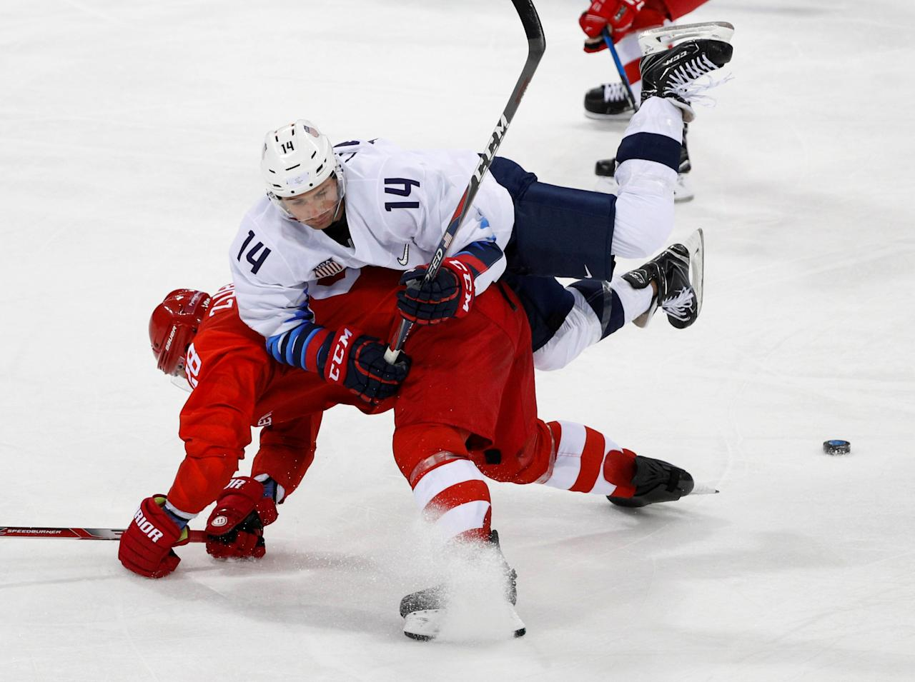 Ice Hockey - Pyeongchang 2018 Winter Olympics - Men's Preliminary Round Match - Olympic Athletes from Russia v U.S. - Gangneung Hockey Centre, Gangneung, South Korea - February 17, 2018 - Broc Little of U.S. in action with Olympic Athlete from Russia Andrei Zubarev. REUTERS/Brian Snyder     TPX IMAGES OF THE DAY