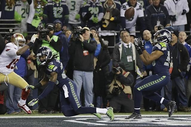 "Malcolm Smith's interception off a pass <a class=""link rapid-noclick-resp"" href=""/nfl/players/24941/"" data-ylk=""slk:Richard Sherman"">Richard Sherman</a> deflected is one of the greatest moments in NFC championship game history. (AP)"