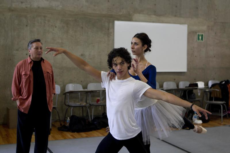 In this Aug. 15, 2012 photo, Isaac Hernandez, Mexico's most internationally acclaimed male ballet dancer, and San Francisco Ballet soloist Victoria Anayan rehearse in Mexico City. Hernandez wants to change ballet in Mexico and aims to lead his countrymen to the practice barre in hopes they will grab on and get hooked, just as he did as a boy. (AP Photo/Dario Lopez-Mills)