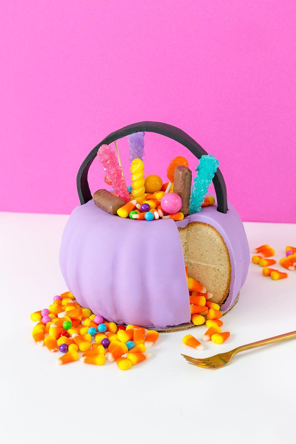 """<p>Kids will definitely approve of this colorful candy-filled snack.</p><p><strong>Get the recipe at <a href=""""http://www.awwsam.com/2017/10/halloween-pumpkin-candy-pail-cake.html"""" rel=""""nofollow noopener"""" target=""""_blank"""" data-ylk=""""slk:Aww Sam"""" class=""""link rapid-noclick-resp"""">Aww Sam</a>.</strong> </p>"""