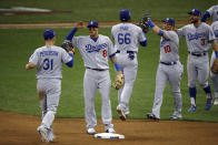 Los Angeles Dodgers players celebrate after Game 2 of the National League Championship Series baseball game against the Milwaukee Brewers Saturday, Oct. 13, 2018, in Milwaukee. The Dodgers won 4-3. (AP Photo/Charlie Riedel)
