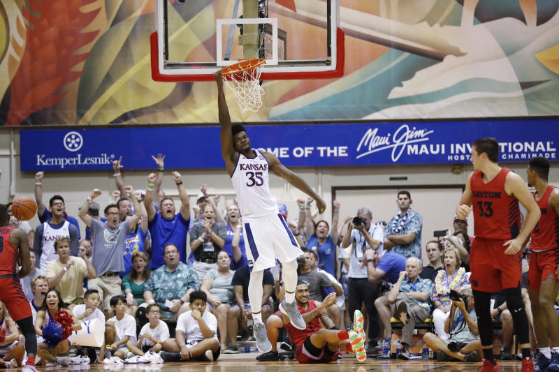 Kansas center Udoka Azubuike (35) hangs off the rim after making a slam dunk over Dayton in overtime of an NCAA college basketball game Wednesday, Nov. 27, 2019, in Lahaina, Hawaii. Kansas defeated Dayton in 90-84 in overtime. (AP Photo/Marco Garcia)