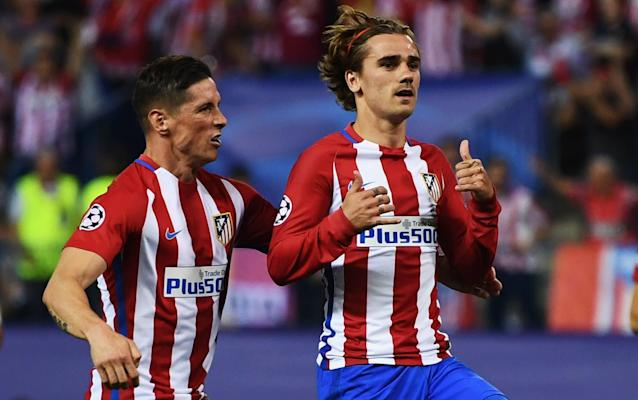 Antoine Griezmann and Fernando Torres celebrate Atletico's goal in the 1-0 victory over Leicester City - Getty Images Europe