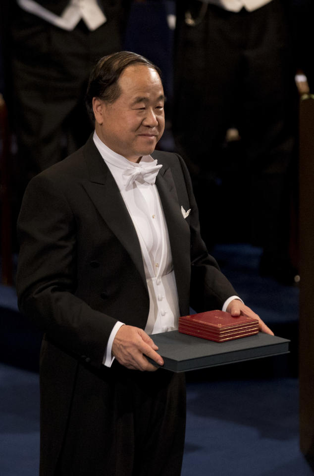 The 2012 Nobel Prize Laureate for Literature China's Mo Yan stands for the applause after receiving his Nobel Prize from Sweden's King Carl XVI Gustaf, not pictured, during the Nobel Prize award ceremony at the Stockholm Concert Hall in Stockholm, Monday, Dec. 10, 2012. The Nobel awards are always awarded on Dec. 10, the anniversary of Alfred Nobel's death in 1896. The prizes for laureates in medicine, chemistry, physics and literature are awarded in the Swedish capital Stockholm, whilst the Nobel Peace Prize is awarded on the same day in Oslo, Norway. (AP Photo/Matt Dunham)