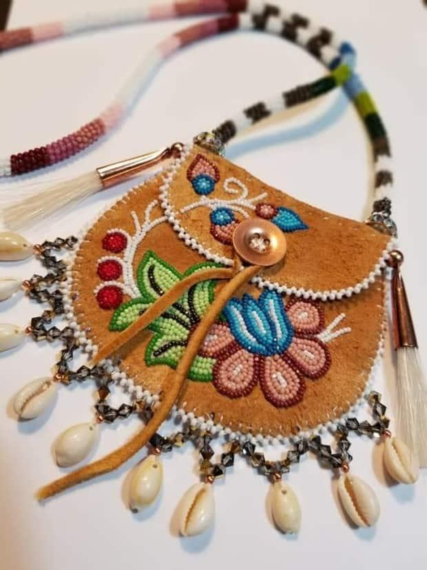 One of Gustafson's pouches with beadwork in a floral design.