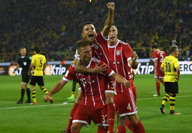Bayern Munich's midfielder Joshua Kimmich (L) and his teammates celebrate after scoring on August 5, 2017 (AFP Photo/PATRIK STOLLARZ)