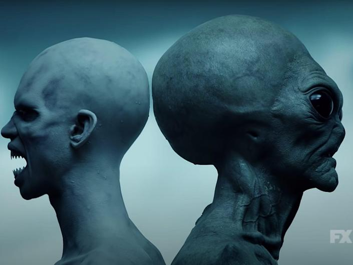 """A still from the teaser trailer of """"American Horror Story: Double Feature"""" showing an alien and a humanoid creature back to back."""