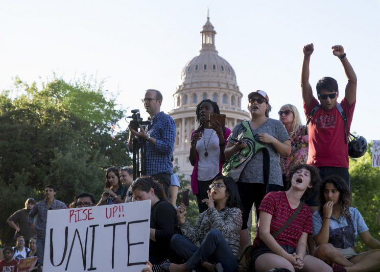 Protesters rally against the sanctuary cities ban in Austin, Texas
