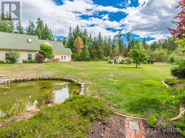 "<p><a rel=""nofollow"">1285 Leffler Rd., Errington, B.C.</a><br /> The property is home to a goldfish pond, fruit trees, a veggie garden, a chicken coop and a fire pit.<br /> (Photo: Zoocasa) </p>"