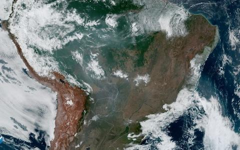 Weather satellites have shown the extent of the wildfires from space - Credit: NASA/NOAA/Reuters