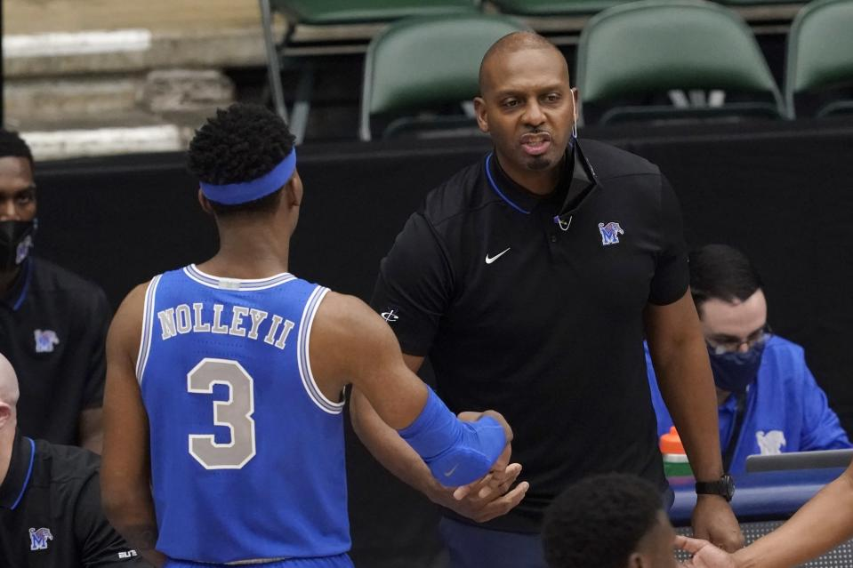 Memphis guard Landers Nolley II (3) walks off the court and is greeted by head coach Penny Hardaway, right, in the second half of an NCAA college basketball game against Colorado State in the semifinals of the NIT, Saturday, March 27, 2021, in Frisco, Texas. (AP Photo/Tony Gutierrez)