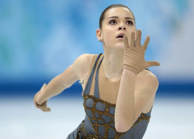 Adelina Sotnikova of Russia competes in the women's free skate figure skating finals at the Iceberg Skating Palace during the 2014 Winter Olympics, Thursday, Feb. 20, 2014, in Sochi, Russia. (AP Photo/Ivan Sekretarev)