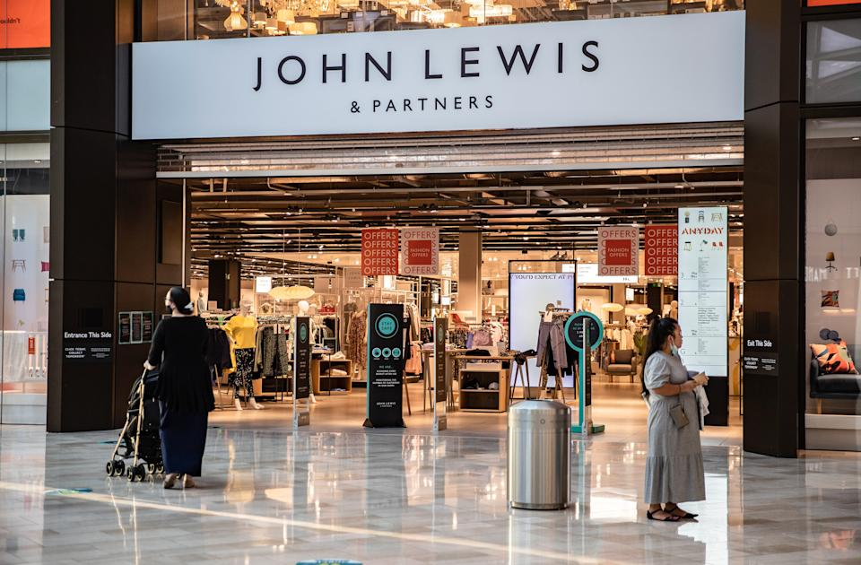 People seen outside John Lewis & Partners, a brand of high-end department stores in London. (Photo by May James / SOPA Images/Sipa USA)