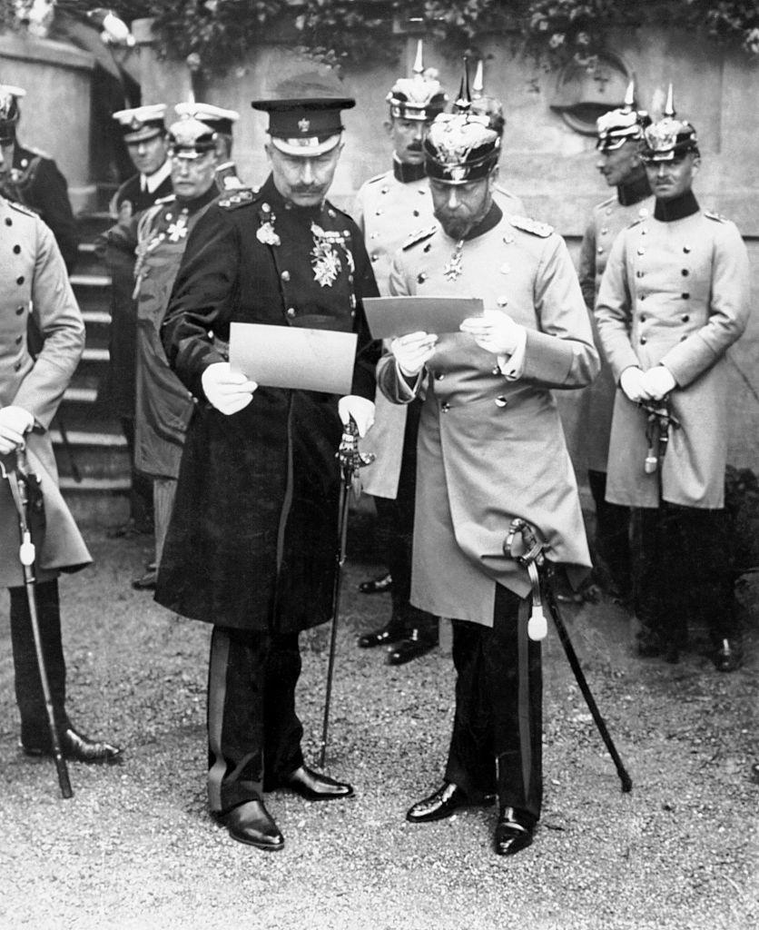 """<p>In the midst of World War I, the British royal family <a href=""""https://www.reuters.com/article/us-britain-wedding-family-timeline-idUSTRE73R89E20110428"""" rel=""""nofollow noopener"""" target=""""_blank"""" data-ylk=""""slk:changed their family name"""" class=""""link rapid-noclick-resp"""">changed their family name</a> from Saxe-Coburg-Gotha to Windsor in order to tone down their German ancestry. Here, King George V is pictured with his cousin, Kaiser Wilhelm of Germany, in Berlin just before the start of the war. </p>"""