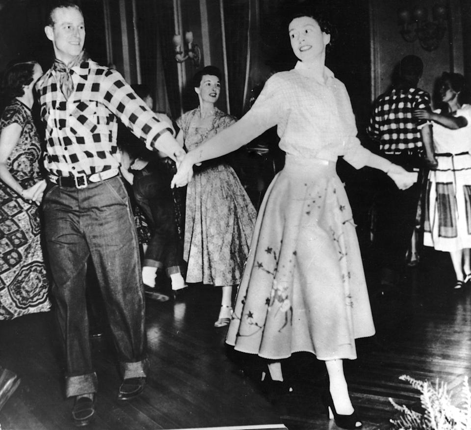 <p>A young Prince Philip dances with his wife, Princess Elizabeth, at a square dance held in their honour by Governor General Viscount Alexander in Ottawa, 1951. <br></p>