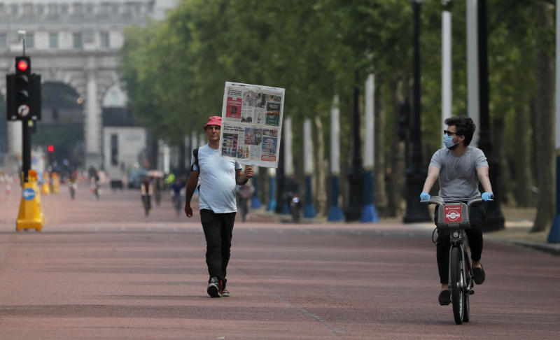 People cycle and jog along The Mall in London, Sunday, May 10, 2020, during the nation-wide coronavirus lockdown. Personal exercise while observing social distancing measures is allowed under government lockdown guidelines.  (AP Photo/Frank Augstein)