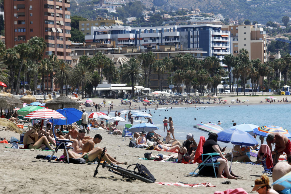 MALAGA, SPAIN -JULY 19 : Sunbathers enjoy along the beach of La Malagueta, on July 19, 2020 in Malaga, Andalucia, Spain. (Photo by Alex Zea/Europa Press via Getty Images)