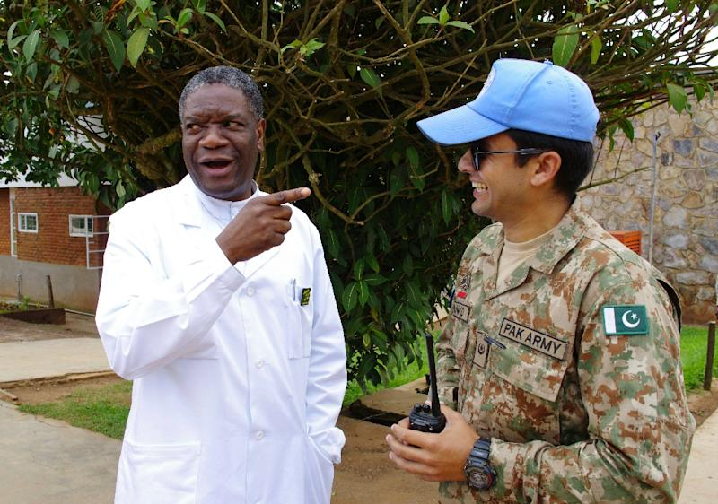 Congolese surgeon and gynaecologist Dr. Denis Mukege (L) chats with a Pakistani MONUSCO soldier tasked with his protection at Panzi Hospital in the outskirts of Bukavu, eastern DR Congo, on March 18, 2015 (AFP Photo/Marc Jourdier)