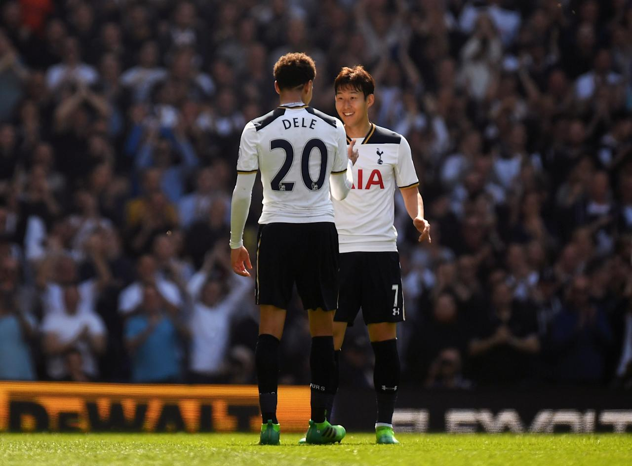 <p>Heung-Min Son celebrates his first goal with Dele Alli</p>