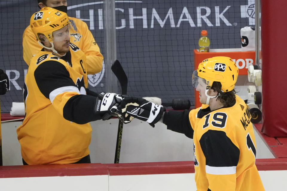 Pittsburgh Penguins' Jared McCann (19) is greeted by Sidney Crosby (87) after scoring against the Philadelphia Flyers during the first period of an NHL hockey game Thursday, March 4, 2021, in Pittsburgh. (AP Photo/Keith Srakocic)