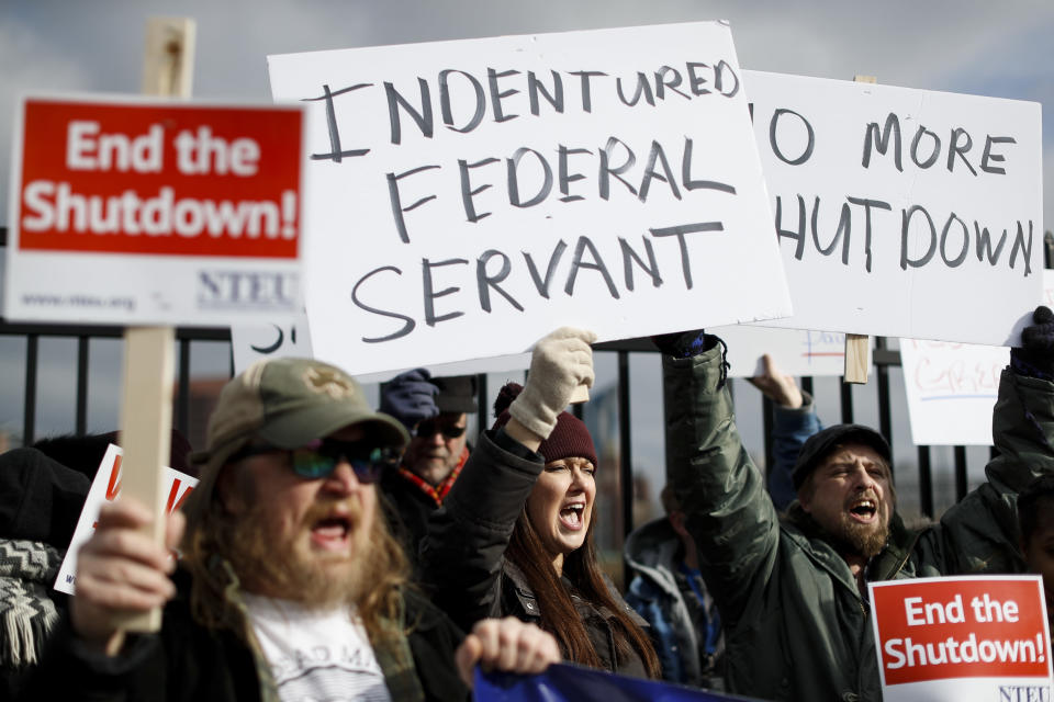 Union members and Internal Revenue Service workers rally outside an IRS Service Center to call for an end to the partial government shutdown, Thursday, Jan. 10, 2019, in Covington, Ky. (Photo: John Minchillo/AP)