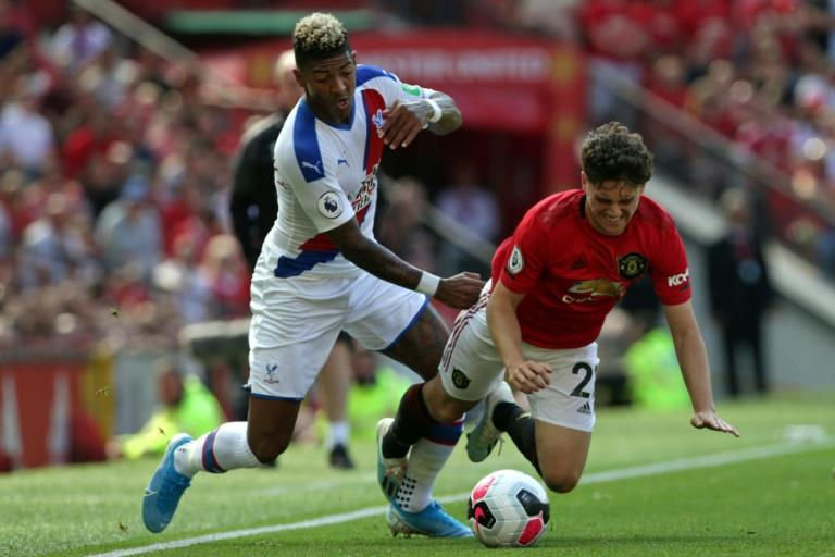 Manchester United midfielder Daniel James vies with Crystal Palace's Patrick van Aanholt
