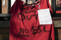 A football shirt is seen outside Liverpool's Anfield Stadium protesting the formation of the European Super League, Liverpool, England, Monday, April 19, 2021. Players at the 12 clubs setting up their own Super League could be banned from this year's European Championship and next year's World Cup, UEFA President Aleksander Ceferin said Monday. (AP Photo/Jon Super)