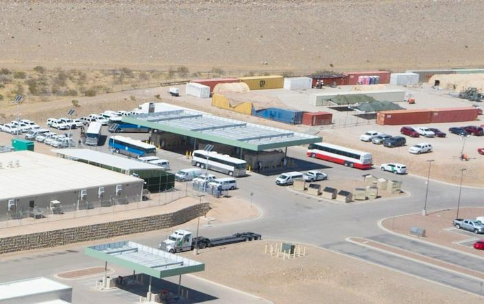 Buses arrive at the U.S. Border Patrol Central Processing Center in Northeast El Paso on March 12, 2021, as migrants can be seen getting off one of the buses.