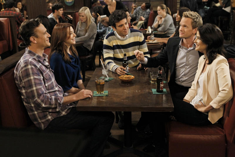 """This undated image released by CBS shows, from left, Jason Segel, Alyson Hannigan, Josh Radnor, Neil Patrick Harris and Cobie Smulders in a scene from """"How I Met Your Mother."""" The sitcom will air its ninth and final season next fall and will at last answer the question about who the mom is, the network said Wednesday, Jan. 30, 2013. That would be the mystery woman with whom Ted, played by Josh Radnor, ultimately has a family.  (AP Photo/CBS, Cliff Lipson)"""