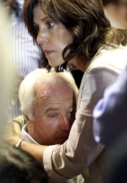 Olympic athlete Oscar Pistorius's father Henke Pistorius is comforted by a unidentified family member during the bail application at the magistrate court in Pretoria, South Africa, Tuesday, Feb. 19, 2013. Pistorius told a packed courtroom Tuesday that he shot his girlfriend to death by mistake, thinking she was a robber. The prosecutor called it premeditated murder. (AP Photo/Themba Hadebe)