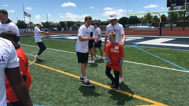 Former Denver Broncos Hit The Field For 'Dare To Play' Football Camp