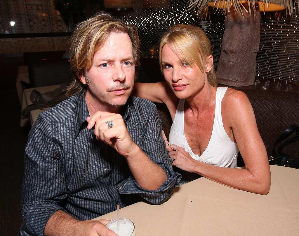 """David Spade and Nicollette Sheridan attend the grand opening of Luau, a Beverly Hills-based restaurant from the mastermind behind LA's other hot spot, Il Sole. John Shearer/<a href=""""http://www.wireimage.com"""" target=""""new"""">WireImage.com</a> - October 22, 2008"""