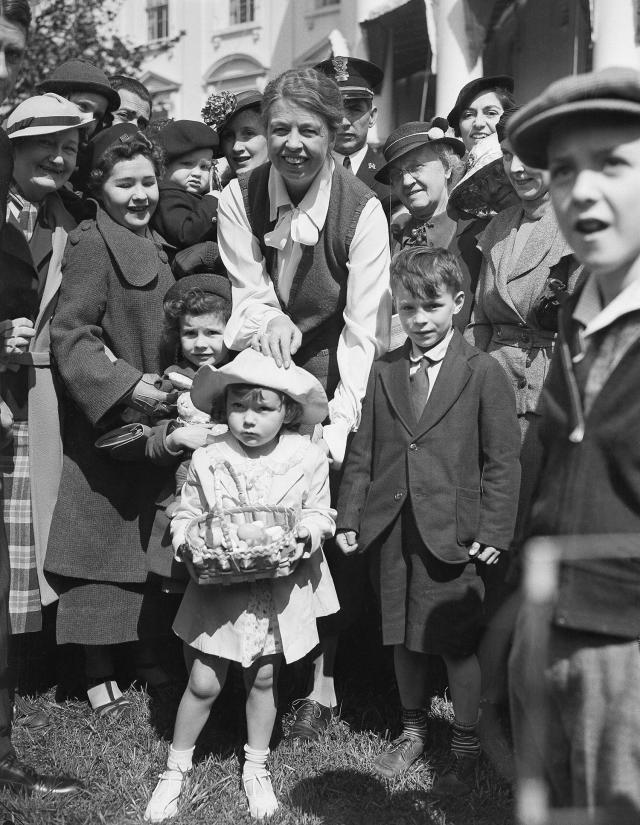<p>First Lady Eleanor Roosevelt pauses to greet 3-year-old Jean Doering of Washington, at the start of the annual Easter Egg Roll at the White House, April 13, 1936. Thousands of children attended. (Photo: AP) </p>