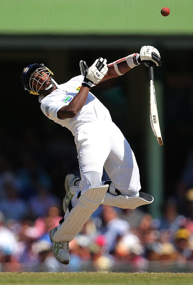 SYDNEY, AUSTRALIA - JANUARY 06:  Nuwan Pradeep of Sri Lanka is hit by a bouncer during day four of the Third Test match between Australia and Sri Lanka at the Sydney Cricket Ground on January 6, 2013 in Sydney, Australia.  (Photo by Brendon Thorne/Getty Images)