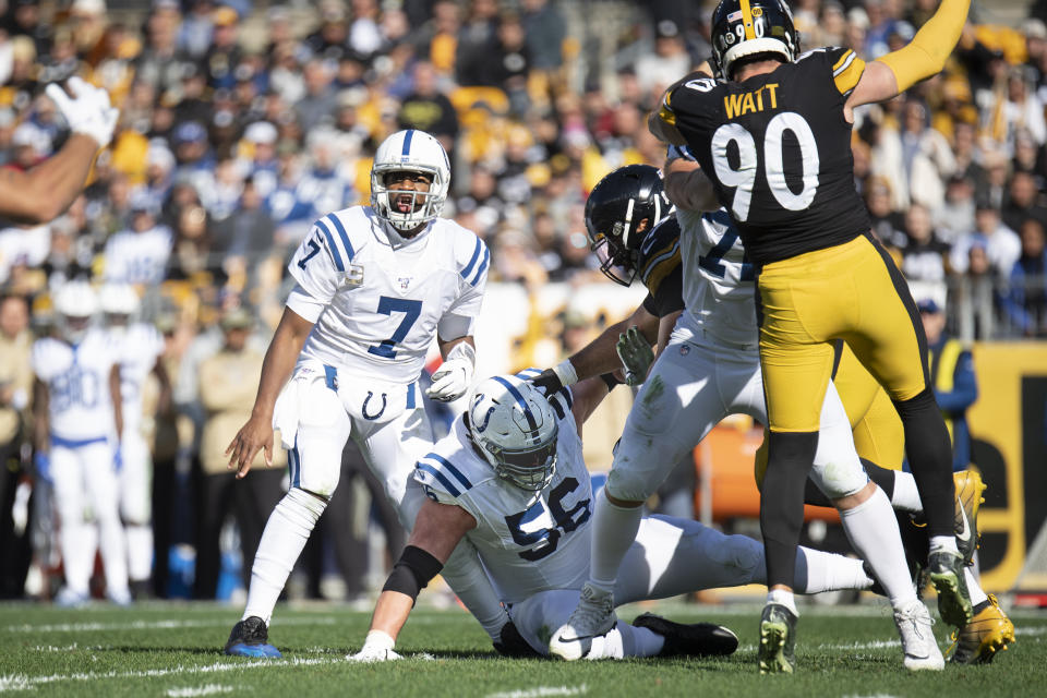 Indianapolis Colts offensive guard Quenton Nelson (56) falls on Colts quarterback Jacoby Brissett's leg on Sunday. (Getty Images)
