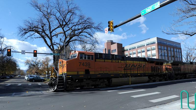 A BNSF Railway train crosses Oak Street in downtown Fort Collins. Additional BNSF trains are expected to pass through the city each day for the next six weeks.
