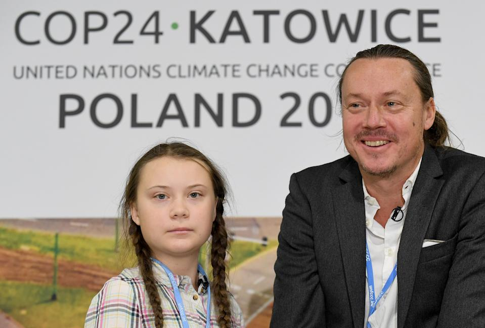 Swedish 15-year old climate activist, Greta Thunberg and her father Svante attend a press conference during the COP24 summit on climate change in Katowice, Poland, on December 04, 2018. - Greta decided to go on school strike every Friday in front of the Swedish parliament to get politicians to act on climate chance following Swedens hottest summer ever. (Photo by Janek SKARZYNSKI / AFP)        (Photo credit should read JANEK SKARZYNSKI/AFP via Getty Images)