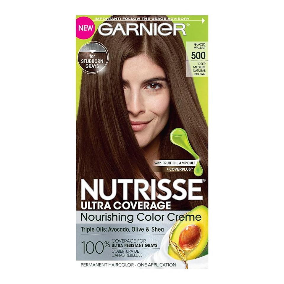 """Garnier Nutrisse Ultra Coverage Nourishing Color Creme makes it easy and affordable to <a href=""""https://www.allure.com/gallery/ten-home-hair-color-kits-under-20?mbid=synd_yahoo_rss"""" rel=""""nofollow noopener"""" target=""""_blank"""" data-ylk=""""slk:color and maintain your hair"""" class=""""link rapid-noclick-resp"""">color and maintain your hair</a> at home. Available in a wide variety of black, brown, blonde, and red shades, this DIY formula is infused with a hydrating blend of avocado, shea, olive, and grapeseed oils to seriously condition hair, so it grasps onto color better and for longer wear. $8, Amazon. <a href=""""https://www.amazon.com/Garnier-Nutrisse-Nourishing-Chocolate-Packaging/dp/B000R039OM/ref=sr_1_1?"""" rel=""""nofollow noopener"""" target=""""_blank"""" data-ylk=""""slk:Get it now!"""" class=""""link rapid-noclick-resp"""">Get it now!</a>"""
