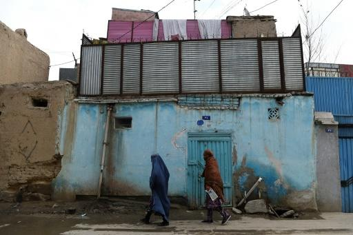 Women walk along a street in the old part of Kabul -- for many in Afghanistan, fear of violence has been replaced by dread the insurgents will crack down on freedoms