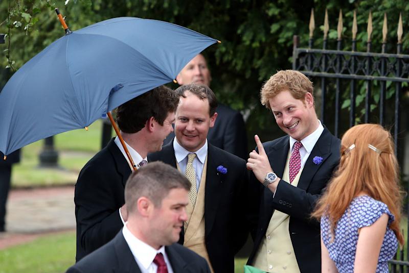 Britain's Prince Harry, right, leaves after attending the wedding of the Duke and Duchess of Northumberland's daughter Lady Melissa Percy to chartered surveyor Thomas van Straubenzee at St Michael's Church in Alnwick, England, Saturday, June 22, 2013. (AP Photo/Scott Heppell)