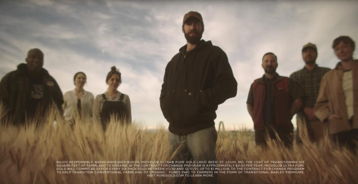 This undated image provided by Michelob ULTRA shows U.S. farmers in a scene from the company's 2020 Super Bowl NFL football spot. Michelob Ultra Pure Gold, promises to create more organic farmland for every six-pack sold. (Michelob ULTRA via AP)