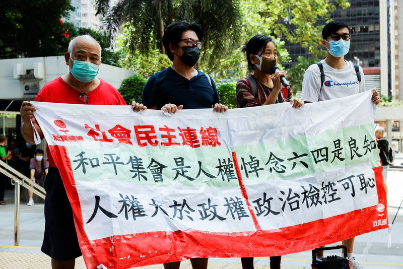 Pro-democracy activists shout slogans outside the court to support activists charged for participating in the assembly on June 4 to commemorate the 1989 crackdown on protesters in and around Beijing's Tiananmen Square