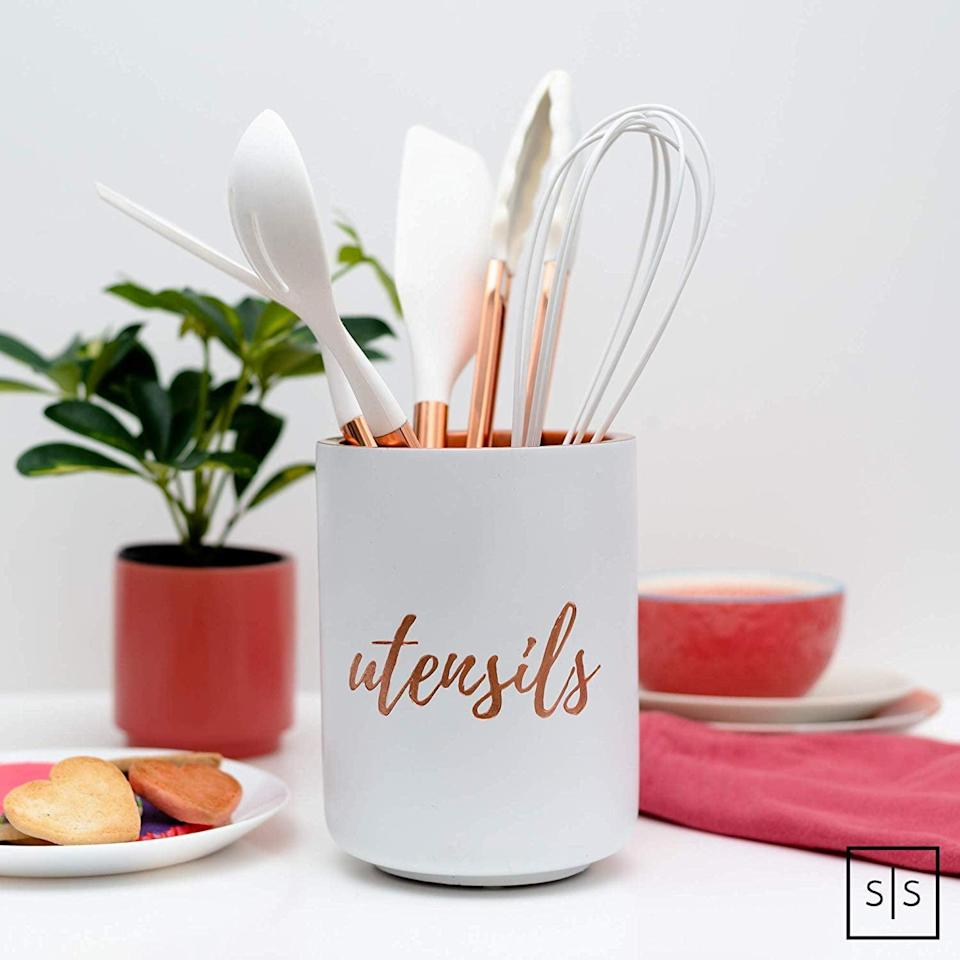 <p>This <span>Copper Utensil Holder</span> ($30) is so adorable.</p>