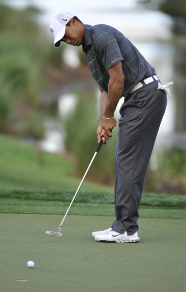 Tiger Woods putts on the sixth green during the pro-am event at the Honda Classic golf tournament in Palm Beach Gardens, Fla., Wednesday, Feb. 29, 2012. (AP Photo/Rainier Ehrhardt)