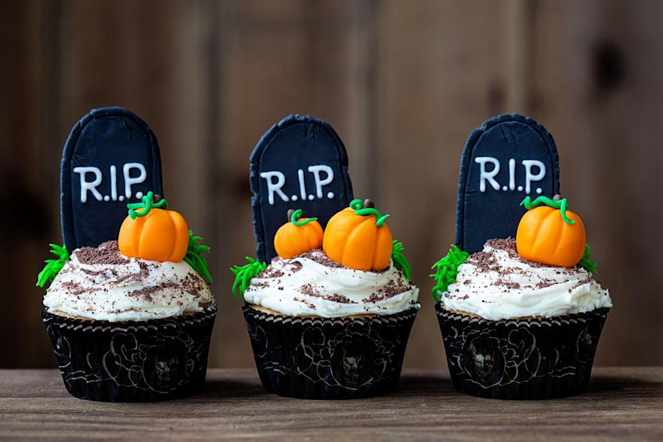 """<p><a href=""""https://www.countryliving.com/life/kids-pets/a23932768/what-time-does-trick-or-treating-start/"""" rel=""""nofollow noopener"""" target=""""_blank"""" data-ylk=""""slk:Halloween"""" class=""""link rapid-noclick-resp"""">Halloween</a> is one of the best times of year to get creative—just think, you're probably already making your own <a href=""""https://www.countryliving.com/diy-crafts/g4571/diy-halloween-costumes-for-women/"""" rel=""""nofollow noopener"""" target=""""_blank"""" data-ylk=""""slk:costume"""" class=""""link rapid-noclick-resp"""">costume</a>, working on the <a href=""""https://www.countryliving.com/diy-crafts/g1189/best-halloween-crafts-ever/"""" rel=""""nofollow noopener"""" target=""""_blank"""" data-ylk=""""slk:best Halloween crafts ever"""" class=""""link rapid-noclick-resp"""">best Halloween crafts ever</a>, and putting up your <a href=""""https://www.countryliving.com/diy-crafts/how-to/g1024/do-it-yourself-halloween-decorations-1010/"""" rel=""""nofollow noopener"""" target=""""_blank"""" data-ylk=""""slk:DIY Halloween decorations"""" class=""""link rapid-noclick-resp"""">DIY Halloween decorations</a>. But, why let your imagination stop at those when you can whip up one of the following Halloween cupcake ideas too? Whether you're hosting a Halloween party, want to satisfy your sweet tooth while watching a <a href=""""https://www.countryliving.com/life/entertainment/g22119835/netflix-halloween-movies/"""" rel=""""nofollow noopener"""" target=""""_blank"""" data-ylk=""""slk:Netflix Halloween movie"""" class=""""link rapid-noclick-resp"""">Netflix Halloween movie</a>, or just want to give your kids seasonal snacks, you should definitely consider these delicious Halloween cupcake ideas.</p><p>Each of these cupcake decorations are incredibly inventive! From """"bleeding"""" vampire bite cupcakes to ghost and spider toppings, these are sure to have family and friends gasping with amazement at how good they look. Don't think you have to be a skilled baker to decorate these <a href=""""https://www.countryliving.com/food-drinks/g1194/halloween-treats/"""" rel=""""nofollow noopener"""" target=""""_blank"""" dat"""