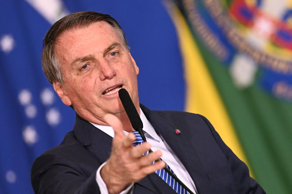 Brazilian President Jair Bolsonaro delivers a speech during the taking office ceremony of his new Chief of Staff Ciro Nogueira at Planalto Palace in Brasilia, on August 4, 2021. - A Supreme Court justice ruled on Wednesday President Jair Bolsonaro should be investigated for unproven claims Brazil's electronic voting system is riddled with fraud, adding the far-right leader to an ongoing probe on the spread of fake news by his government. (Photo by EVARISTO SA / AFP) (Photo by EVARISTO SA/AFP via Getty Images)