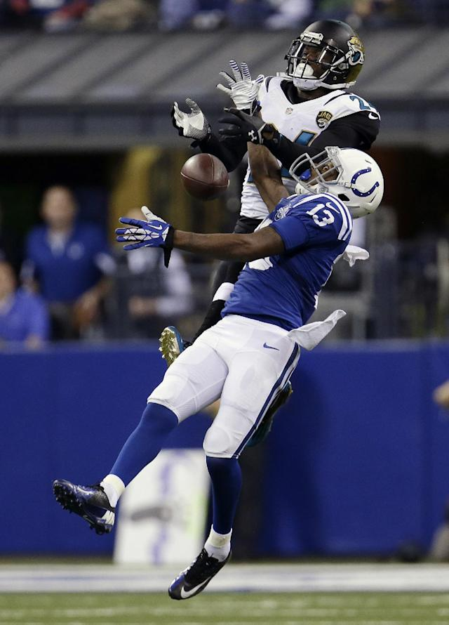 Indianapolis Colts' T.Y. Hilton (13) is defended by Jacksonville Jaguars' Will Blackmon while leaping to make a catch during the first half of an NFL football game on Sunday, Dec. 29, 2013, in Indianapolis. The pass was incomplete. (AP Photo/AJ Mast)